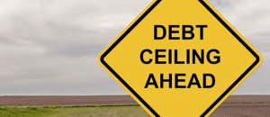 "Yield sign that reads ""Debt Ceiling Ahead"""