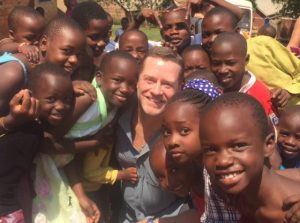 Surrounded by Children in Uganda