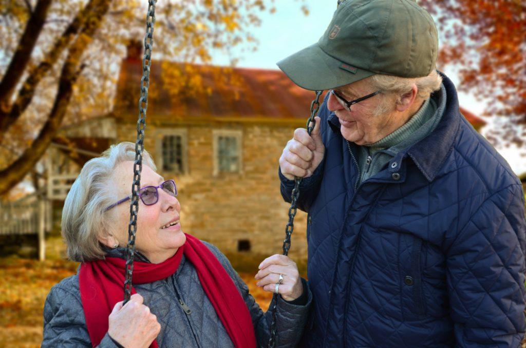 Elderly couple on a swing