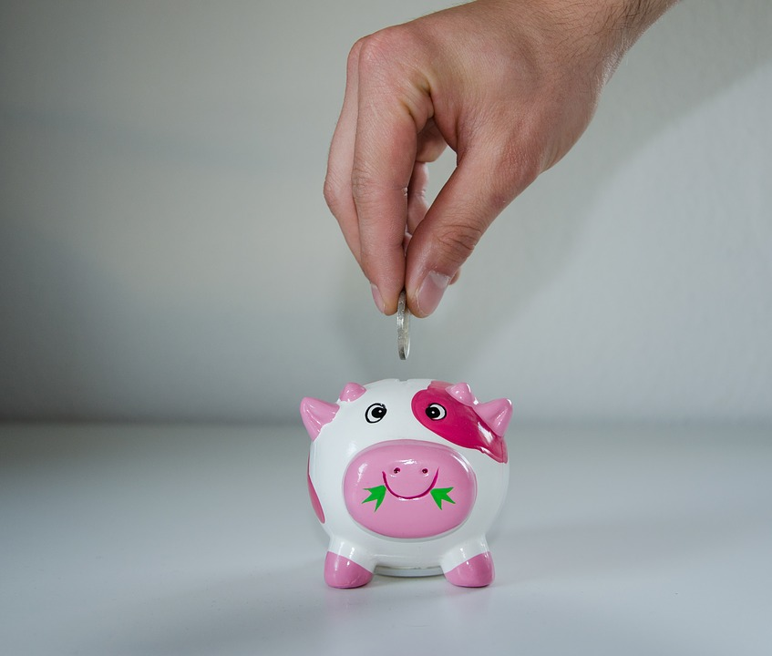 Dropping money in a piggy bank