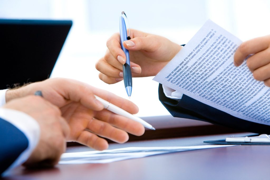 Deal contract writing hands