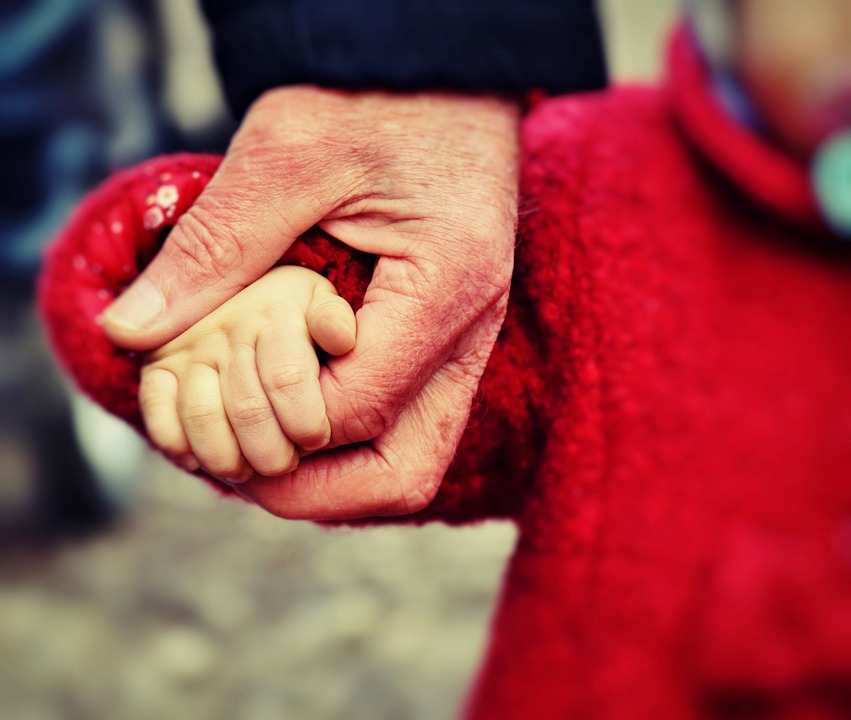 ABLE hand holding father daughter
