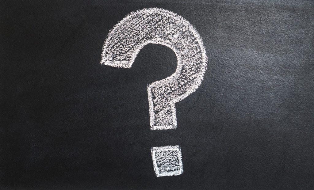 white Question Mark Written on black chalkboard