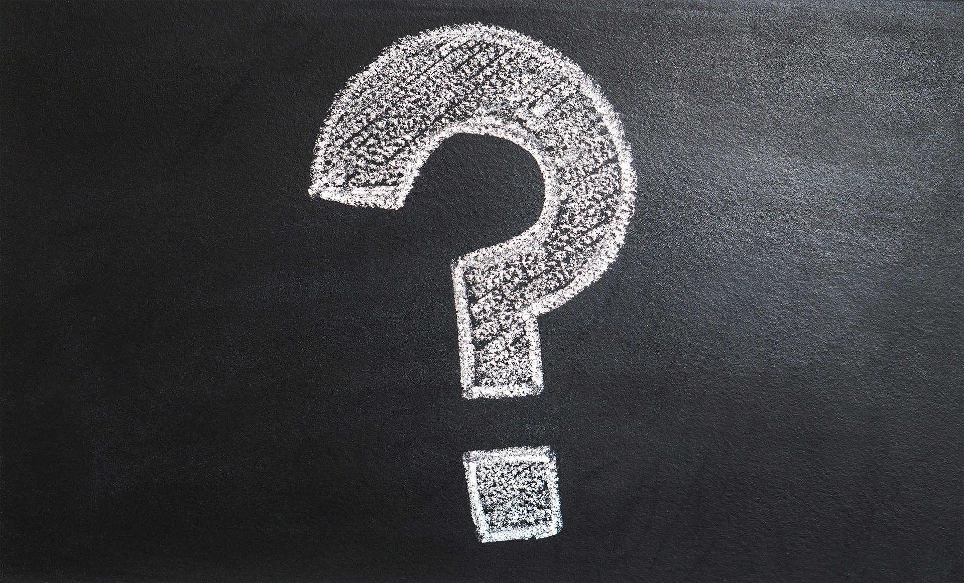white Question Mark Written on black chalkboard to retire