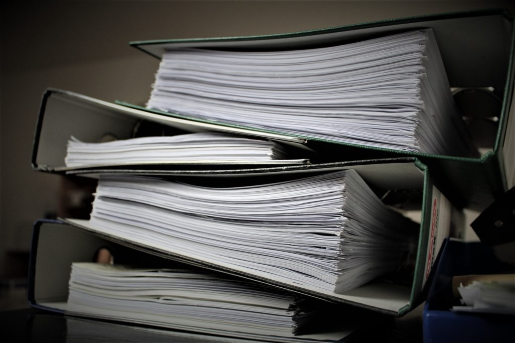 SECURE stack of binders and papers