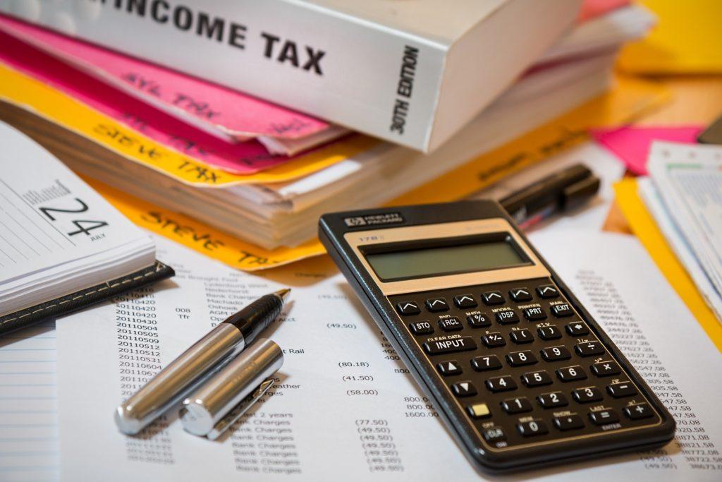 income tax calculator binder pen spreadsheet