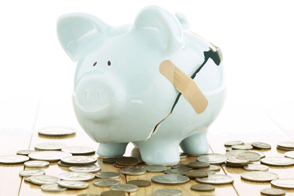 Broken Piggy Bank money habits