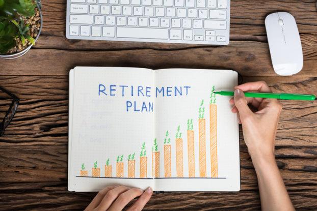 Retirement Plans Notebook on Desk