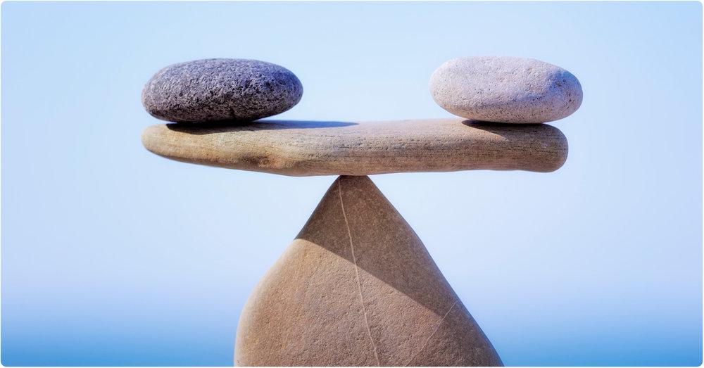 rebalancing stones on pyramid