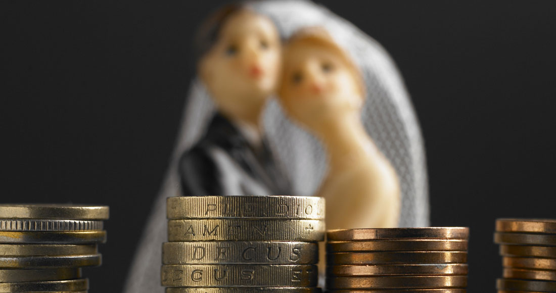 wedding couple in front of money