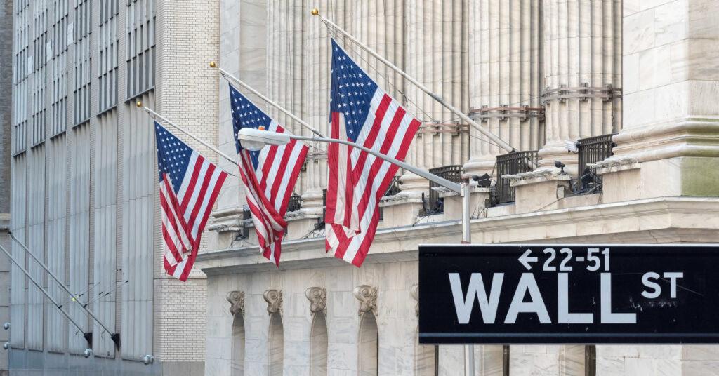 Wall Street Sign American Flag
